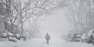 A man walks up the middle of a street in Toronto as a snow storm hits with strong winds and heavy snow on Monday, February 2, 2015. THE CANADIAN PRESS/Darren Calabrese